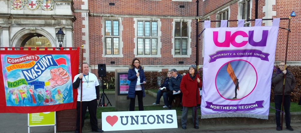 Beth Farhrat and banner speaking